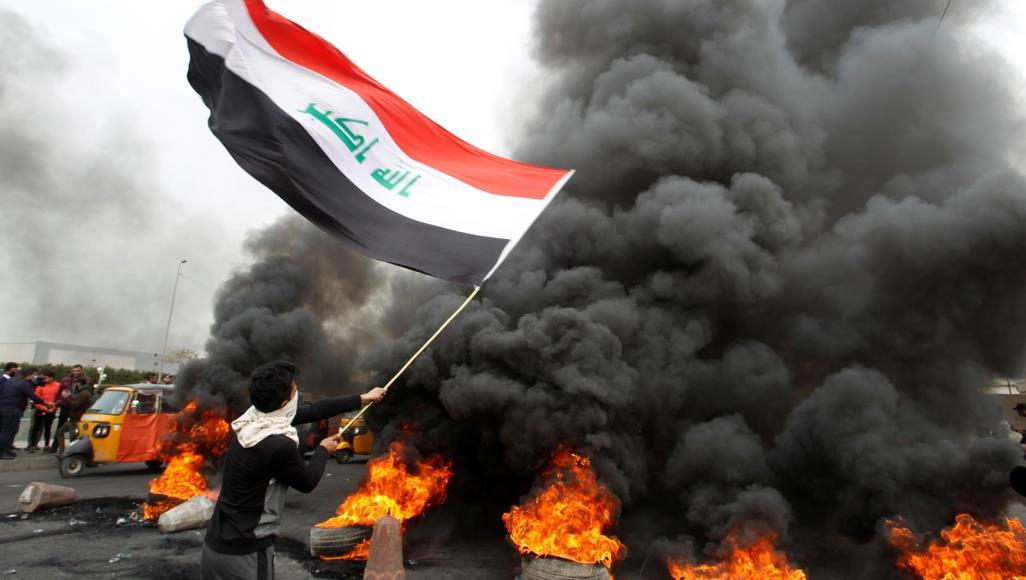 Demonstrators block a main road in Nasiriyah